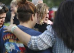 Madilyn Williams, a senior at Santa Fe High School, talks with friends during community dinner behind Texas First Bank, Saturday, May 19, 2018 in Santa Fe, Texas. A gunman opened fire inside the school Friday, May 18, 2018, killing several people. (Jennifer Reynolds/The Galveston County Daily News via AP)