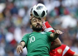 Saudi Arabia's Mohammed Alsahlawi, foreground, jumps for the ball with Russia's Alexander Samedov during the group A match between Russia and Saudi Arabia which opened the 2018  World Cup at the Luzhniki stadium in Moscow, Russia, Thursday, June 14, 2018. (AP Photo/Hassan Ammar)