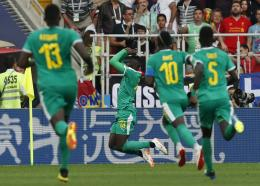 Senegal's Mbaye Niang, 2nd left, celebrates with teammates after scoring his side's second goal during the group H match against Poland at the 2018 football World Cup in the Spartak Stadium in Moscow, Russia, Tuesday, June 19, 2018. (AP Photo/Darko Vojinovic).