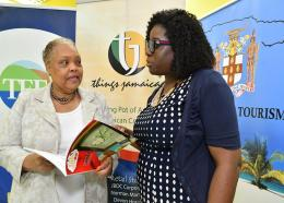 Director of the Tourism Linkages Network, Carolyn McDonald-Riley and CEO of the Jamaica Business Development Corporation, Valerie Viera discuss the contents of the 2017 Christmas in July corporate gift catalogue, following the opening ceremony of the assessment session for this year's Christmas in July event.