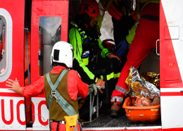 Firefighters load an injured person on a helicopter after the Morandi highway bridge collapsed in Genoa, northern Italy, Tuesday, Aug. 14, 2018. (Luca Zennaro/ANSA via AP)