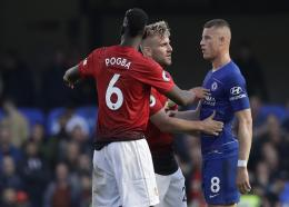 Manchester United defender Luke Shaw, center and Paul Pogba argue with Chelsea's Ross Barkley, right, after he scored his side's second goal during their English Premier League football match at Stamford Bridge stadium in London Saturday, Oct. 20, 2018.