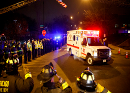 Police and firefighters salute as an ambulance arrives at the medical examiner's office carrying the body of Chicago Police Department Officer Samuel Jimenez, who was killed during a shooting at Mercy Hospital earlier in the day, Monday, Nov. 19, 2018, in Chicago. (Armando L. Sanchez/Chicago Tribune via AP)