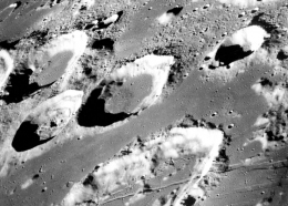 This Dec. 29, 1968 photo made available by NASA shows the large moon crater Goclenius, foreground, approximately 40 statute miles in diameter, and three clustered craters Magelhaens, Magelhaens A, and Colombo A, during the Apollo 8 mission (NASA via AP, File).