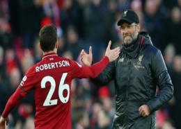 Jurgen Klopp celebrates with Andy Robertson.