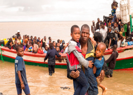 In this photo supplied by the Red Cross Red Crescent Climate Centre survivors of Cyclone Idai arrive by rescue boat in Beira, Mozambique, Thursday, March 21, 2019. (Photo -Denis Onyodi - Red Cross Red Crescent Climate Centre via AP)