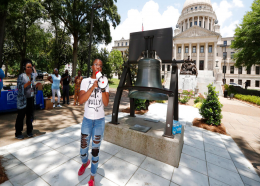 Amanda Furdge of Jackson and a mother of three boys, relates her experience seeking an abortion in the state, as she addresses abortion rights advocates at the Capitol in Jackson, Miss., during a rally to voice their opposition to state legislatures passing abortion bans that prohibit most abortions once a fetal heartbeat can be detected, Tuesday, May 21, 2019. The rally in Jackson was one of many around the country to protest abortion restrictions that states are enacting. (AP Photo/Rogelio V. Solis)