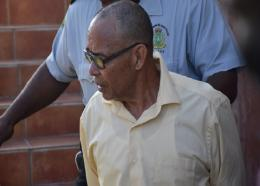 Andre Stedman being escorted from court. Photo courtesy BVI news.