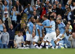 Manchester City's Gabriel Jesus, centre, celebrates with teammates after scoring a disallowed goal during the English Premier League football match against Tottenham Hotspur at Etihad stadium in Manchester, England, Saturday, Aug. 17, 2019. (AP Photo/Rui Vieira).