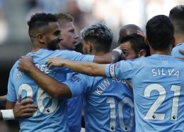 Manchester City's Riyad Mahrez, left, celebrates with teammates after scoring his sides third goal during the English Premier League football match against Watford at the Etihad stadium in Manchester, England, Saturday, Sept. 21, 2019. (AP Photo/Rui Vieira).