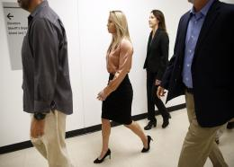 Fired Dallas police Officer Amber Guyger (center) arrives for jury selection in her murder trial at the Frank Crowley Courthouse in downtown Dallas, Friday, Sept. 13, 2019. (Tom Fox/The Dallas Morning News via AP)