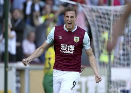 Burnley's Chris Wood celebrates scoring his side's first goal of the game during the English Premier League football match against Norwich City at the Turf Moor Stadium, Burnley, England. Saturday, Sept. 21 2019. (Richard Sellers/PA via AP).