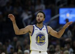 In this Oct. 5, 2019, file photo, Golden State Warriors guard Stephen Curry gestures against the Los Angeles Lakers during a preseason NBA basketball game in San Francisco.