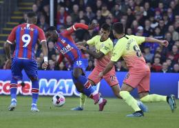 Crystal Palace's Jeffrey Schlupp vies for the ball with Manchester City's Joao Cancelo during the English Premier League football match at Selhurst Park in London, England, Saturday, Oct. 19, 2019. (AP Photo/Rui Vieira)