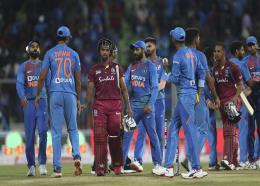 West Indies' Nicholas Pooran, third left, and Lendl Simmons, third right, shake hands with Indian players after their win in the second Twenty20 international cricket match between India and West Indies in Thiruvanathapuram, India, Sunday, Dec. 8, 2019. (AP Photo/Aijaz Rahi)