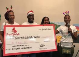 Suga Lifestyle's Gabrielle Burgess presents a $100,000 cheque to the Marie Atkins Shelter at the Suga Lifestyle Christmas Connection trade show held on December 15 at the Jamaica Pegasus hotel.