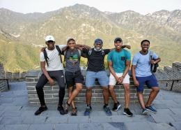 Jamaican students share the frame as they strike a pose during their journey up the Great Wall of China.
