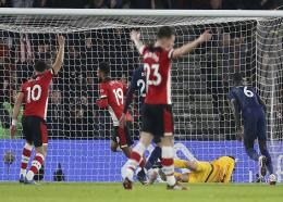 Southampton's Sofiane Boufal turns to celebrate after equalising against Tottenham during their FA Cup fourth round football match at St Mary's Stadium, Southampton, England. Saturday, Jan. 25, 2020. (Steven Paston/PA via AP).