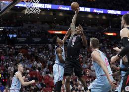 Los Angeles Clippers forward Kawhi Leonard (2) drives to the basket as Miami Heat forward Jimmy Butler defends during the first half of an NBA basketball game, Friday, Jan. 24, 2020, in Miami. (AP Photo/Lynne Sladky).