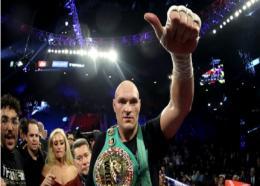 Tyson Fury celebrates.