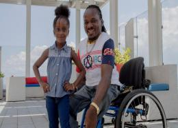 Paralympian Alphanson Cunningham with his 4 year old daughter Aleahana