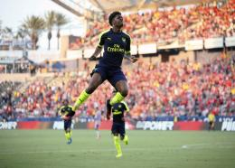 In this file photo dated Sunday, July 31, 2016, Arsenal's Chuba Akpom leaps after scoring aginst Chivas Guadalajara during a friendly football match in Carson, California, USA.  (AP Photo/Danny Moloshok, FILE).