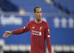 Liverpool's Virgil van Dijk during the English Premier League football match against Everton at Goodison Park in Liverpool, England, Sunday, June 21, 2020. (/Pool via AP).