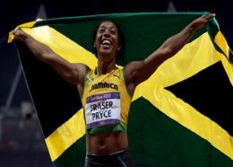 Shelly-Ann Fraser-Pryce of Jamaica celebrates winning the gold in the Women's 100m final on Day 8 of the London 2012 Olympic Games at Olympic Stadium on August 4, 2012. (PHOTO: World Athletics).