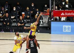 Los Angeles Lakers forward Kyle Kuzma (0) takes a backward shot against the Houston Rockets during the first half of an NBA basketball game Thursday, Aug. 6, 2020, in Lake Buena Vista, Fla. (Kim Klement/Pool Photo via AP).
