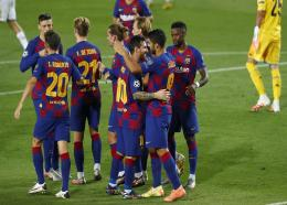 Barcelona's Luis Suarez (right) celebrates with Lionel Messi and other teammates after scoring his side's third goal during the Champions League round of 16, second leg football match against Napoli at the Camp Nou Stadium in Barcelona, Spain, Saturday, Aug. 8, 2020. (AP Photo/Joan Monfort).