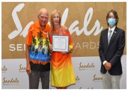 Winners of the ONE million Sandals Select Reward members award Dorothy and Charles Williams, accepting congratulations from Sandals General Manager Ramel Sobrino.