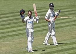 New Zealand's Kane Williamson celebrates his double century during play on day two of the first cricket test between the West Indies and New Zealand in Hamilton, New Zealand, Friday, December 4, 2020. (Andrew Cornaga/Photosport via AP)