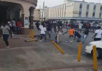 A still from the video of persons involved in a brawl on Wharf Road yesterday.