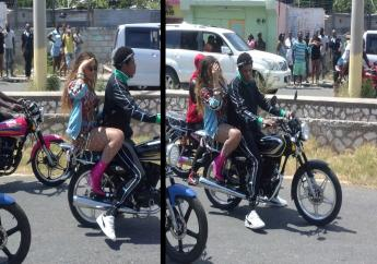 Beyonce and Jay Z on a motorbike during a video shoot in Trench Town on Tuesday afternoon.