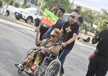 This woman, pictured in a wheelchair being pushed by her son, travelled from London to Kingston to witness the Long Walk to Freedom show. She said she knows Banton personally and therefore could not miss the concert. (PHOTOS: Marlon Reid)