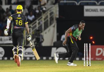 Jade Dernbach (left) of Jamaica Tallawahs runs out by Sheldon Cottrell of St Kitts and Nevis Patriots during match 16 of the Hero Caribbean Premier League at Sabina Park on Thursday, September 19, 2019 in Kingston, Jamaica. (Photo by Randy Brooks - CPL T20/Getty Images).