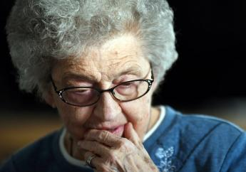 In this undated photo, Edna Schmeets, 90, reflects on being scammed out of her life savings by Jamaican criminals, at her home in Harvey, North Dakota (Mike McCleary/The Bismarck Tribune via AP)