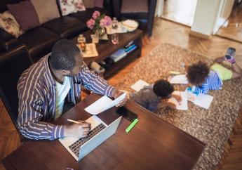 iStock photo of father working from home.