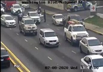 Screengrab of the Jamaica Eye footage of the arrest of four suspected robbers in traffic on Wednesday.