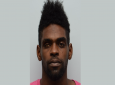 (Photo: 26-year-old Miguel Mc Clean aka 'One Eye, Bad Eye', of East Dry River, Port of Spain, and a 17-year-old teenager were charged with the murders of Trevvon Wilson and his neighbour, Tiba Thomas.)