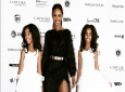 Kim Porter in happier times with her twin daughters