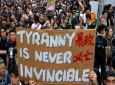 Tens of thousands of protesters carry posters and banners march through the streets as they continue to protest an extradition bill, Sunday, June 16, 2019, in Hong Kong. (AP Photo/Kin Cheung)