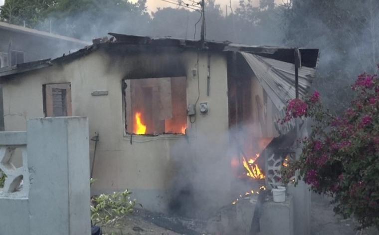 A dwelling in Farm Heights, St James on fire on Friday afternoon.
