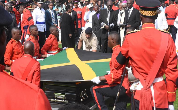 Military personnel lowering the casket with the body of former Prime Minister, Edward Seaga, into his final resting place at National Heroes Park in Kingston on Sunday. (Photos: Marlon Reid)