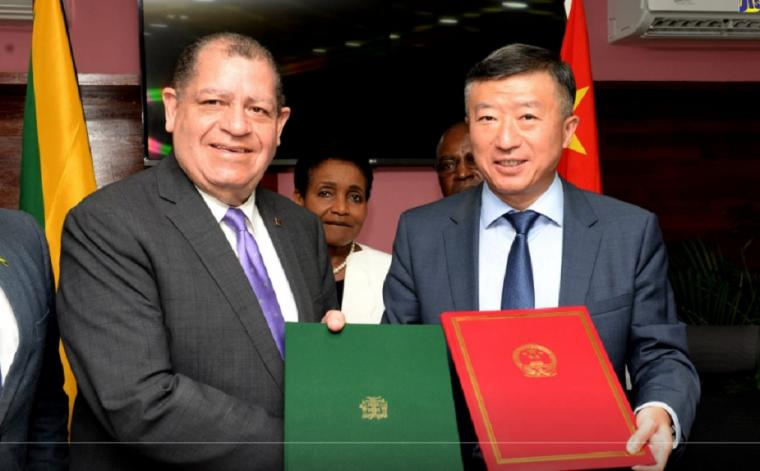 Minister of Industry, Commerce, Agriculture and Fisheries, Audley Shaw (left)., shakes hands with Ambassador of the People's Republic of China, His Excellency Tian Qi. Occasion was the signing of a protocol governing the export of frozen lobster to China, at the Ministry's Hope Gardens offices in St. Andrew.
