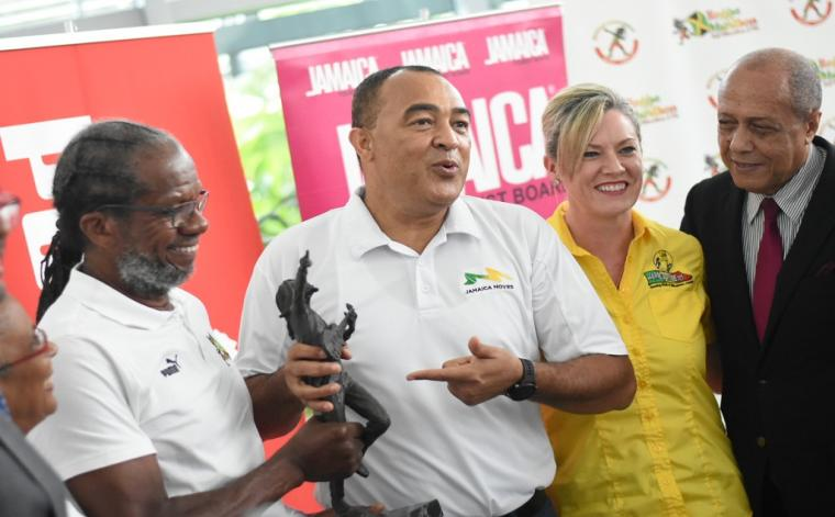 (From left) Reggae Marathon race director, Alfred 'Franno' Francis; Health Minister Dr Christopher Tufton; Jamdammers Running Club president Aileen Corrigan; and Adviser in the Ministry of Sport, Ali McNab share a light moment at the Reggae Marathon launch at the Digicel headquarters in Kingston on Wednesday. (Photos: Marlon Reid)