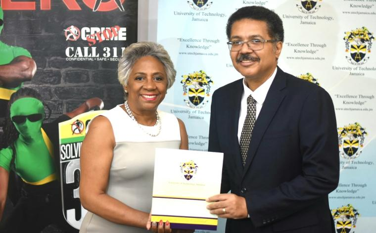Sandra Glasgow, chairperson of the National Crime Prevention Fund, through which Crime Stop Jamaica operates and UTech President, Professor Stephen Vasciannie. (Photo: Marlon Reid).