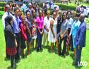 (from right) Education Minister Ronald Jones, Chief Education Officer Karen Best and Deputy Education Officer Joy Adamson with some of the 2017 Barbados Scholarship and Exhibition winners.