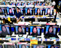 TV screens at an electrical appliance store show the image of doomsday cult leader Shoko Asahara in news reports, in Urayasu, near Tokyo, Friday, July 6, 2018. (Kyodo News via AP)