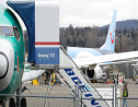 In this photo taken Monday, March 11, 2019, a Boeing 737 MAX 8 airplane being built for TUI Group sits parked in the background at right at Boeing Co.'s Renton Assembly Plant in Renton, Wash. (AP Photo/Ted S. Warren)